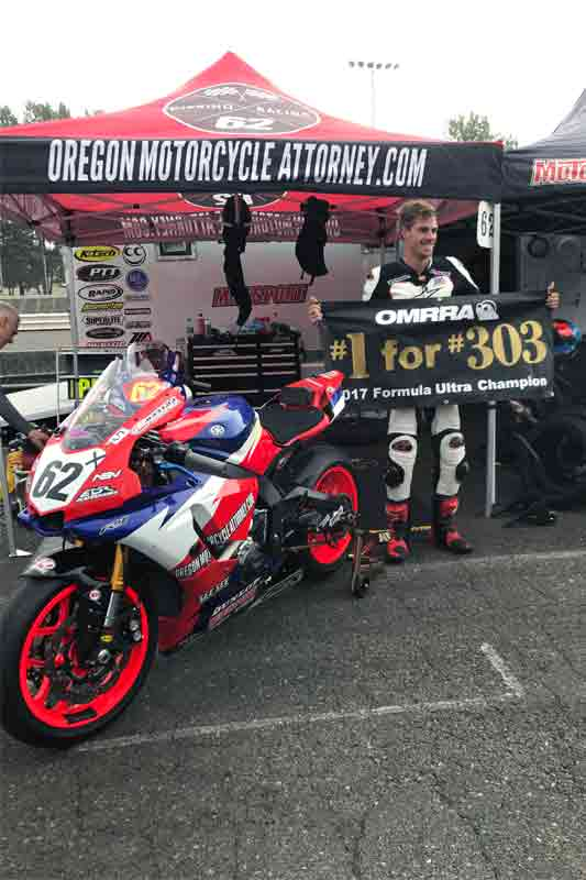 Andy DiBrino Racing #62 at his HQ holding #1 for #303 tribute sign at Portland International Raceway after winning the 2017 Formula Ultra Championship