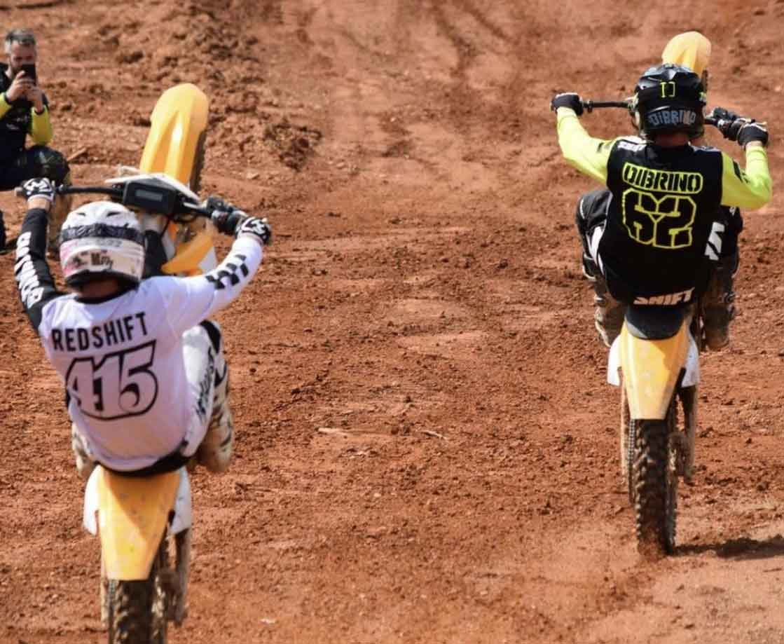 Andy DiBrino and Jimmy Hill doing wheelies on Alta motorcycles at Highland Park in Georgia