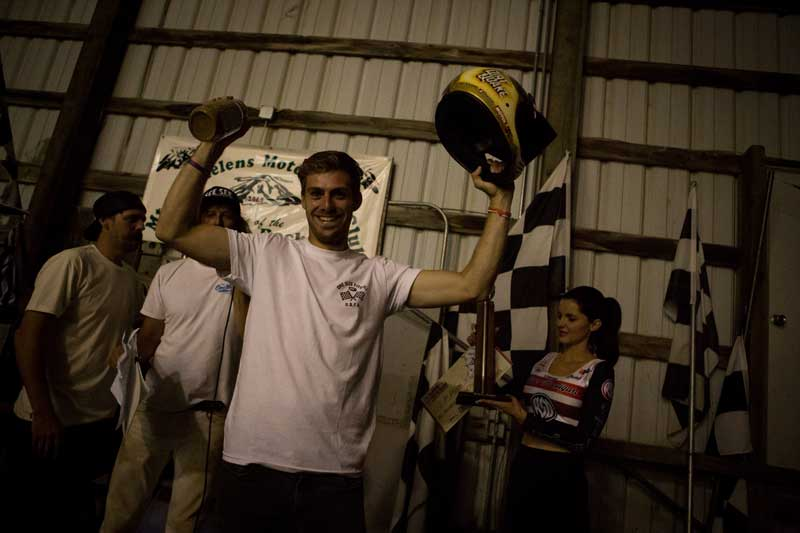 Andy with a win trophy at Dirtquake USA with the special victory helmet from Hooligan Series.