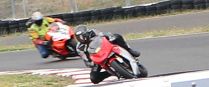 fast motorcycles on a turn pursuit from OregonMotorcycleAttorney.com Mike Colbach   sponsored PSSR track day at Portland International Raceway 7/18/16.