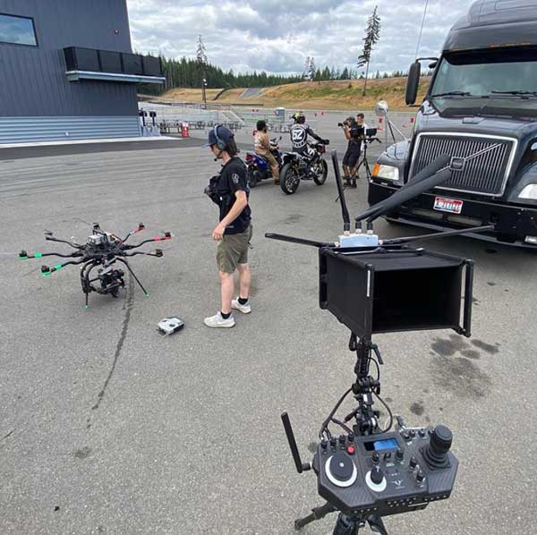 Andy's film shoot at The Ridge Motorsports Park underway with drone camera, hand held cameras, hooligan motorcycle going