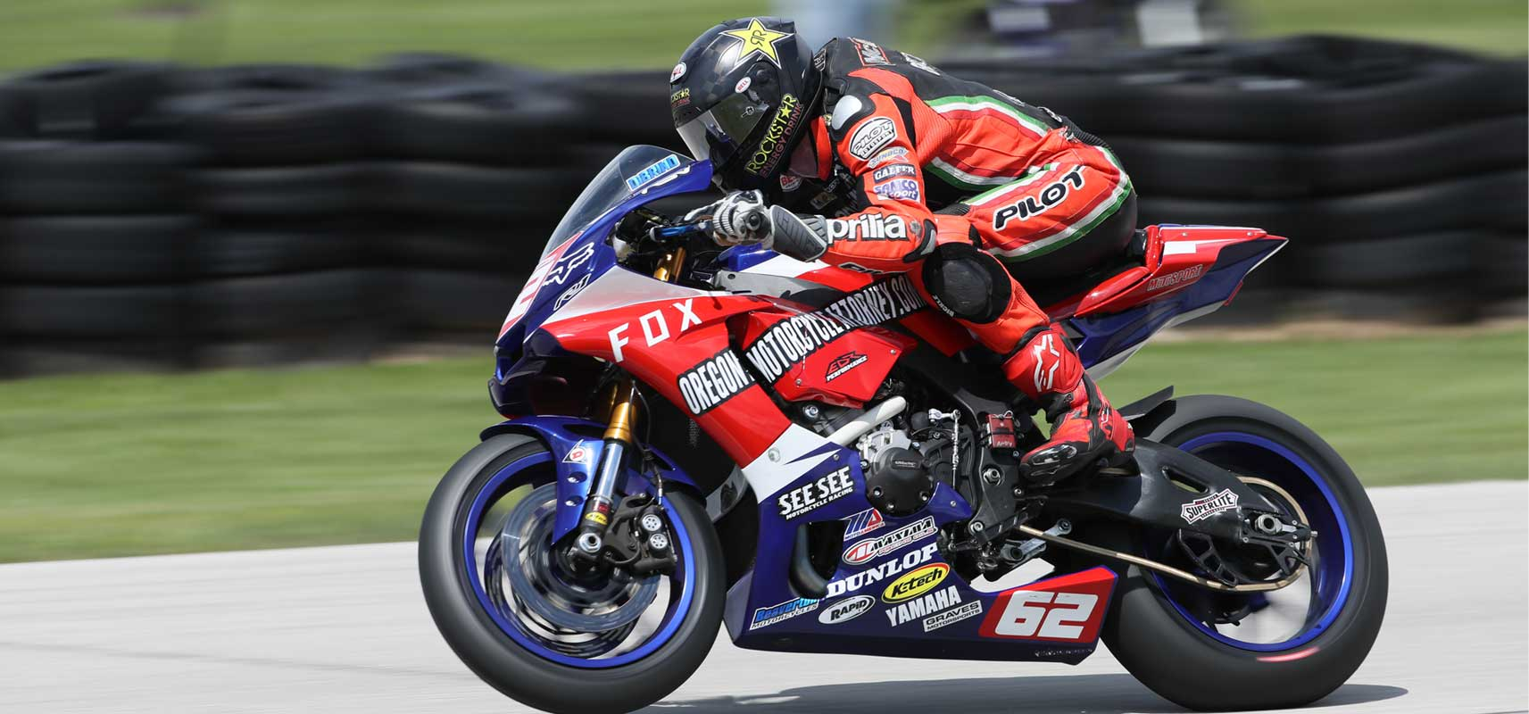 Andy DiBrino riding tight and aerostreamed ripping down the track MotoAmerica Wisconsin on his EDR Performance R1 - maybe a little wheelie but we'll have to ask Andy.