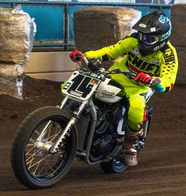 On the gas charging on the Harley Hooligan bike on his way to a heat win.