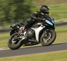 Portland motorcycle injury accident lawyer Mike Colbach rides his CBR 600 at PIR during a PSSR track day