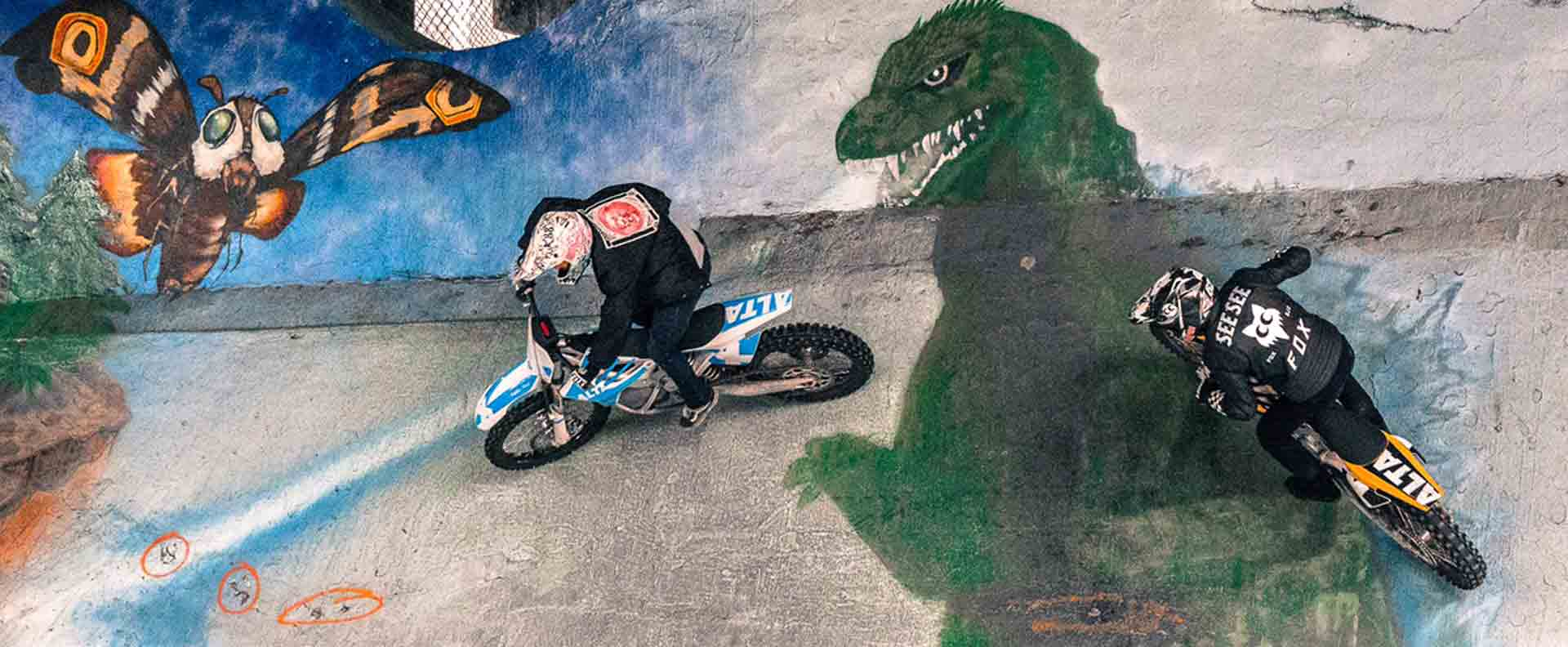 Andy with See See friend Jimmy Hill freestyle motocrosser riding steep slope with Godzilla at Burnside skate park in Portland, Oregon