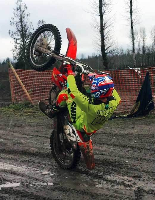 Andy DiBrino wheelie time on his MX motorcycle and a little Oregon mud